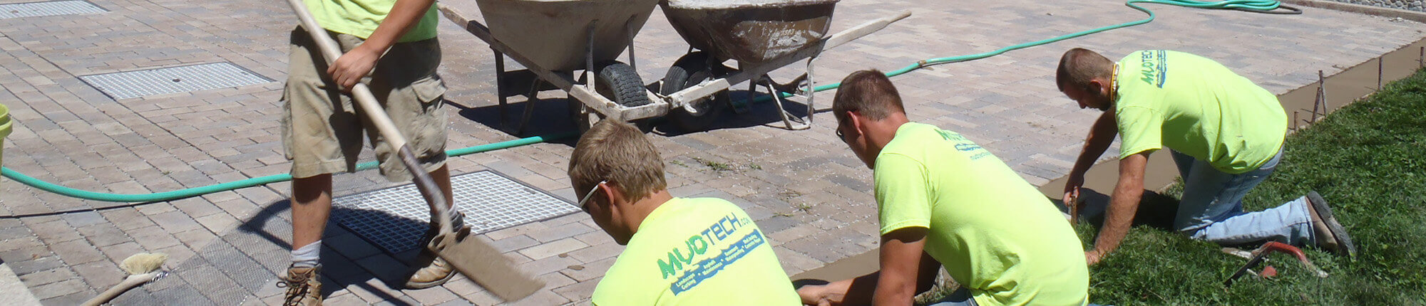 MUDTeCH technicians at work on a pavement repair job.