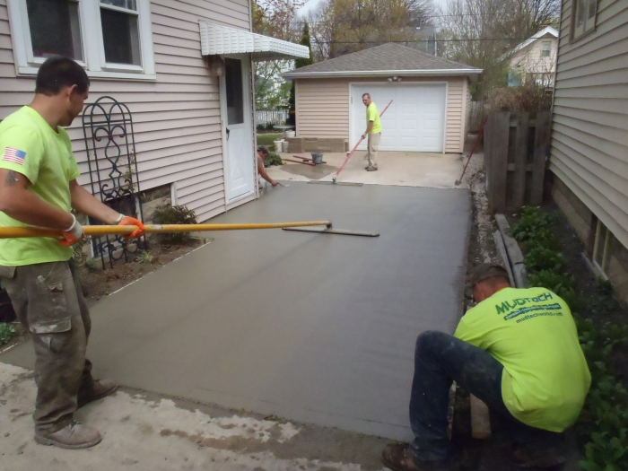 Wales concrete driveway pouring mudtech wisconsin for How to pour a concrete driveway