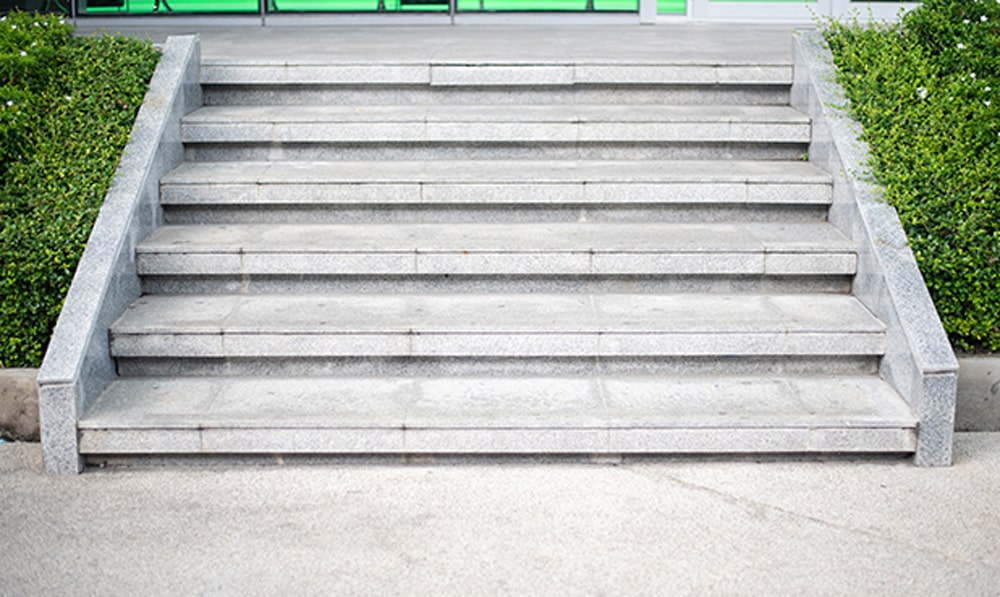 Concrete steps and sidewalks need to be kept in good shape at businesses.