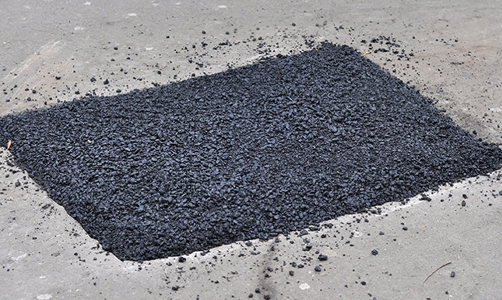 Patched section of asphalt